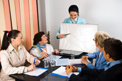 Presentation on board at business meeting. Business woman making a presentation and indicate with pencil on blank board at meeting,copy space for text message Stock Images