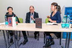 Presentation of Book `Queen of the grass-snakes` by lithuanian writer Vytautas V. Landsbergis at the Vilnius book fair stock photo