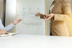 Presentation in business group meeting show chart graph. On board Royalty Free Stock Images