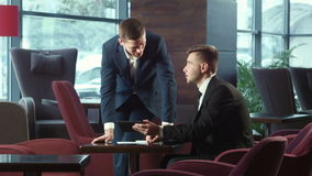 Presentation of the business plan using the touchpad. The businessman explains the business plan and shows to the interlocutor on the touchpad stock video