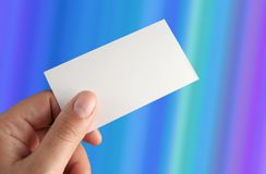 Presentation card. Hand holding a presentation card over a gradient back ground clippinng path included Stock Photography