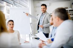 Presentation and collaboration by business people. In office royalty free stock images