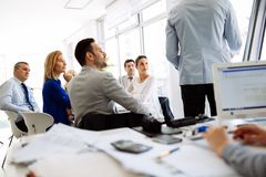 Presentation and collaboration by business people Royalty Free Stock Photography