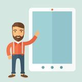 Presentation Concept. Happy young man with beard doing presentation on the tablet screen Royalty Free Stock Photography