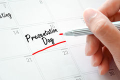 Presentation Day texts on the calendar (or desk planner). Underlined with red marker Royalty Free Stock Photo