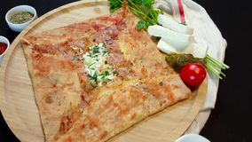 Delicious crepe with cheese served with appetizers and tea on a wooden board. Presentation of delicious crepe with cheese served with appetizers and tea on a stock video footage