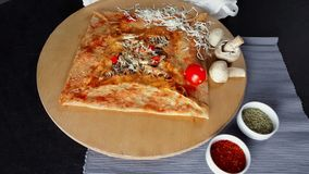 Delicious crepe with mushroom and cheese served with seasonings on a wooden board. Presentation of delicious crepe with mushroom and cheese served with stock footage