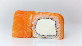 Presentation of delicious sushi rolls with raw salmon and creame cheese stock video
