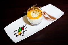 Tiramisu with caramel. Presentation of the dessert tiramisu with caramel Stock Images
