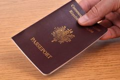 Presentation of a European passport. Travel concept with a person presenting his European passport in closeup stock illustration