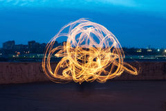 Presentation with fiery light painting streaks Royalty Free Stock Image