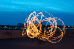 Presentation with fiery light painting streaks Royalty Free Stock Photography