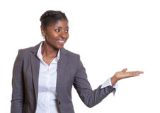 Presentation of a happy African business woman Royalty Free Stock Photography