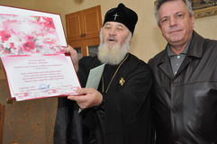 The presentation of honorary diplomas, medals and ribbons Honorary citizen of the city of Gomel Bishop of the Russian Orthodox Chu Royalty Free Stock Images