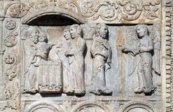 Presentation of Jesus in the Temple and angel appeared to Joseph in a dream to tell him to flee to Egypt. Medieval relief on the facade of Basilica of San Zeno royalty free stock images