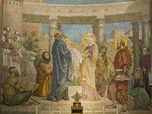 The presentation of Jesus in the Temple. Mosaic of the Presentation of Jesus at the temple in the Rosary Basilica at Lourdes stock images