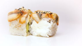 Presentation of Luxury Japan Restaurant sushi dish Piro maki Rotating on white plate. Macro shot. stock video