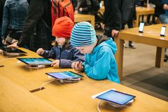 Berlin, October 2, 2017: presentation of the new advanced tablet Ipad Pro in the official Apple store. Young buyers came Stock Photo