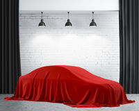 Presentation of New Car With Question Mark wrapped under a sheet Gift red bow, Close up a new car hidden under cover. Royalty Free Stock Photography