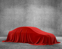 Presentation of New Car With Question Mark wrapped under a sheet Gift red bow, Close up a new car hidden under cover. Stock Photography