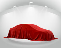 Presentation of New Car With Question Mark wrapped under a sheet Gift red bow, Close up a new car hidden under cover. Royalty Free Stock Photo