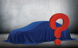 Presentation of New Car With Question Mark wrapped under a sheet Gift red bow, Close up a new car hidden under cover. Royalty Free Stock Image