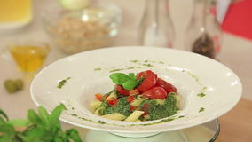 Presentation of Pasta with Green Pesto, Basil and stock video
