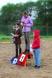 Presentation of prizes to the winners of competitions in dressage horses. Royalty Free Stock Photos