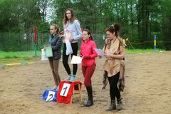 Presentation of prizes to the winners of competitions in dressage horses. Royalty Free Stock Photo