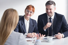Presentation of professional strengths. Recruiters are listening with satisfaction the presentation of female job applicant Royalty Free Stock Image