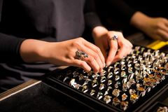 Presentation of retail showcase in jewellery store with rings.  stock images