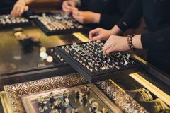 Presentation of retail showcase in jewellery store with rings stock image