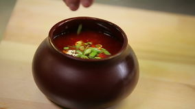 Presentation and serving russian borscht with sour. Cream stock video footage