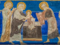 The presentation in the temple, a Romanesque fresco Royalty Free Stock Images