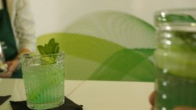 Presentation of two non-alcoholic cocktails based on cucumber, mint and lime, moktel, barmenshow, barmen competition. Moktel 4k stock footage