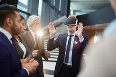 Presentation of virtual information. One of modern politicians in vr headset commenting what he sees on virtual display at conference Royalty Free Stock Images