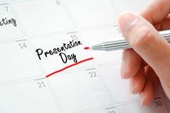 Presentationsdagtexter på kalendern (eller skrivbordstadsplanerare) Royaltyfri Foto