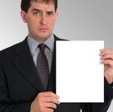 Presentazione laterale dell'uomo d'affari (spazio in bianco) Immagini Stock
