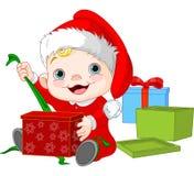 Presente aberto do bebê do Natal Imagens de Stock Royalty Free