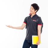 Presente asiático joven del estudiante algo. Imagen de archivo libre de regalías