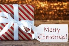 Presente atmosférico com etiqueta, Feliz Natal Foto de Stock