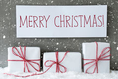 Presente branco com flocos de neve, Feliz Natal do texto Imagens de Stock