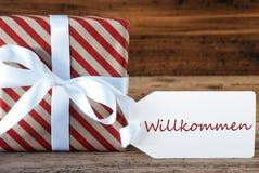 Presente com etiqueta, boa vinda dos meios de Willkommen imagens de stock