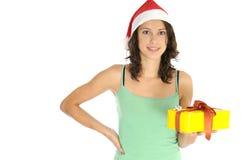 Presente de Natal da terra arrendada da menina imagem de stock royalty free