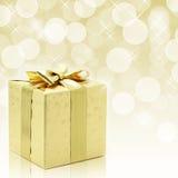 Presente de Natal dourado Fotografia de Stock