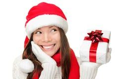 Presente do Natal da terra arrendada da menina de Santa Imagens de Stock
