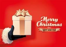 Presente do Natal da terra arrendada de Santa Fotografia de Stock Royalty Free