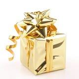 Presente dorato isolato Fotografia Stock