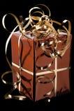 Presente dourado Imagem de Stock