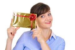 Presente dourado lustroso Fotografia de Stock Royalty Free